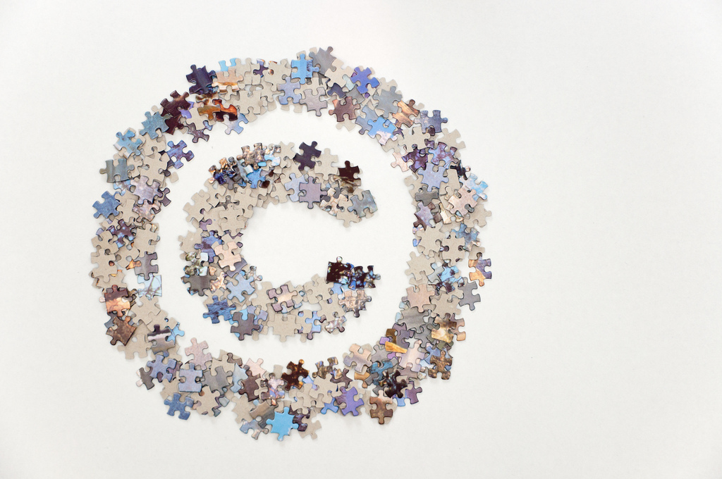"""""""Large copyright sign made of jigsaw puzzle pieces"""" by Horia Varlan 2010 CC BY 2.0"""